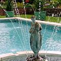 Lady In Fountain by Ed Weidman