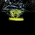 Lemon Dropped Into Water  by Sharon Zilberczveig
