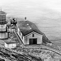 Lighthouse On The Point by Mick Burkey