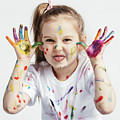 Little Girl Covered In Paint Making Funny Faces. by Michal Bednarek