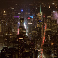Midtown Manhattan Skyline Aerial At Night by David Oppenheimer