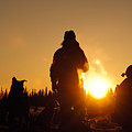 Mushers At Sunrise by Chip Laughton