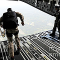 Navy Seals Jump From The Ramp Of A C-17 by Stocktrek Images
