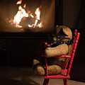 Old Teddy Bear Sitting Front Of The Fireplace In A Cold Night by Andrea Varga