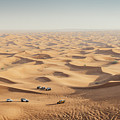 One 4x4 Vehicle Off-roading In The Red Sand Dunes Of Dubai Emirates, United Arab Emirates by Alexandre Rotenberg