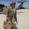 Pararescuemen Walks Away From A Hh-60g by Terry Moore