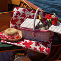 Picnic Basket On A Wooden Boat by Les Palenik
