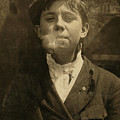 Portrait Of A Boy Smoking A Pipe by Everett