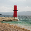 Red Lighthouse Of Cres On A Cloudy Day In Spring by Stefan Rotter