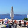 Restaurant By The Aegean Sea  In Santorini, Greece  by Oana Unciuleanu
