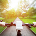 Riding A Bike First Person Perspective. Smartphone On Handlebar. Speed Motion Blur by Michal Bednarek