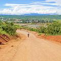 Road Landscape In Tanzania by Marek Poplawski