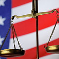 Scales Of Justice And American Flag by Sami Sarkis