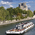 Sightseeing Boat On River Seine To Louvre Museum. Paris by Bernard Jaubert