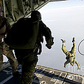 Special Operations Jumpers Exit A C-130 by Stocktrek Images