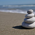 Stack Of Pebbles On Beach by Sami Sarkis
