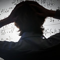 Student Holding His Head Looking At Complex Math Formulas On Whiteboard by Michal Bednarek
