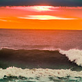 Sunrise Kissing Surf by Michael Goodin