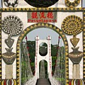 Suspension Bridge With Tribal Decorations by Yali Shi