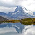 The Matterhorn And Lake Stellisee by Jeffrey Hamilton
