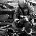 The Praying Firefighter Black And White by Dana Blalock