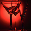 Three Empty Cocktail Glasses On Red Background by Oleg Yermolov