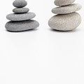 Two Stacks Of White And Gray Pebbles by Sami Sarkis
