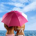 Two Women Relaxing On A Shore by Oleksiy Maksymenko