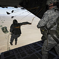 U.s. Airmen Jump From A C-130 Hercules by Stocktrek Images