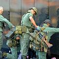 Veterans At Vietnam Wall by Carolyn Marshall