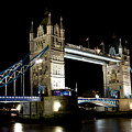 View Of The River Thames And Tower Bridge At Night by David Pyatt