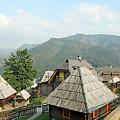 Village On Mountain Rural Landscape by Goce Risteski