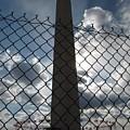 Washington Monument Through Fence by Ben Schumin