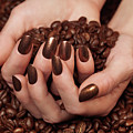 Woman Holding Coffee Beans In Her Hands by Oleksiy Maksymenko