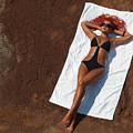 Woman Sunbathing by Oleksiy Maksymenko