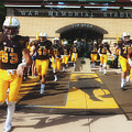 Wyoming Cowboys Entering The Field by Library Of Congress