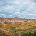 Yellow Mounds Of Badlands Np by Michael Ver Sprill
