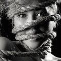 Young Expressive Woman Tied In Ropes by Oleksiy Maksymenko
