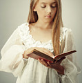 Young Girl Reading A Book by Amanda Elwell