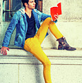 Young Man Reading Red Book, Sitting On Street by Alexander Image