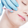 Young Woman Having Botox Face Injections. by Michal Bednarek