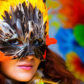 Young Woman With A Colorful Feather Carnival Face Mask On Bright Colorful Background Eye Contact by Jozef Klopacka
