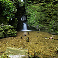 Beautiful Flowing Waterfall With Magical Fairytale Feel In Lush  by Matthew Gibson