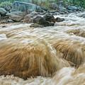 River Water Flowing Through Rocks At Dawn by Rudra Narayan Mitra