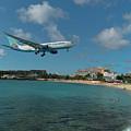 Air Caraibes Landing At St. Maarten by David Gleeson