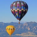 2 Balloons Flying Over The Flatirons by Scott Mahon