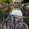 Bicycle Parked At The Bridge In Amsterdam. Netherlands. Europe by Bernard Jaubert