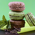 Chocolate And Mint Flavor Macaroons On Dark Wood Table by Milleflore Images