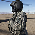 Crew Chief Of A Ch-47 Chinook Stands by Terry Moore