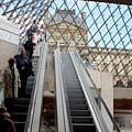 Escalator Entrance To Louvre by Carl Purcell